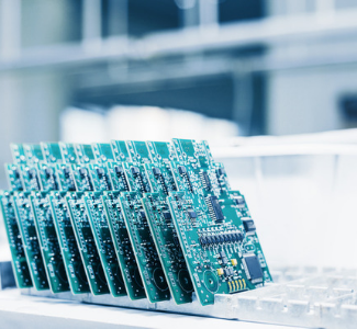 Stack of Advanced Assembly circuit boards under bright white light